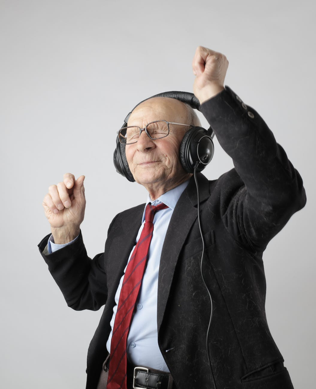 man in black jacket wearing black headphones